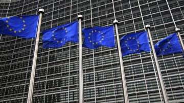 European Union flags fly in front of the European Commission headquarters in Brussels