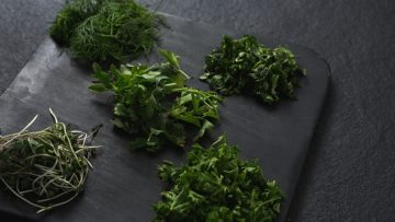 Various herbs on chopping board